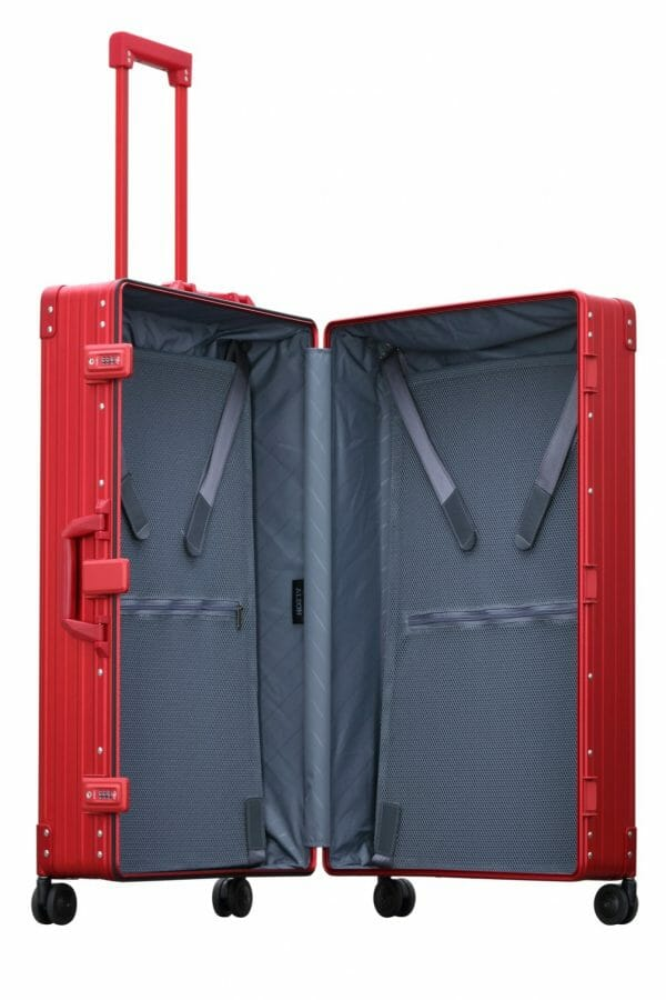checked luggage open trunk style red