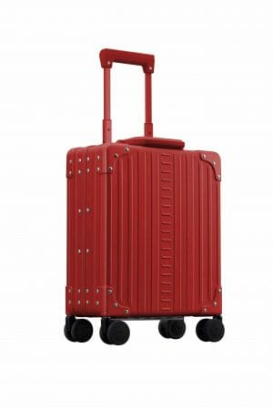 Red carry on aluminum luggage