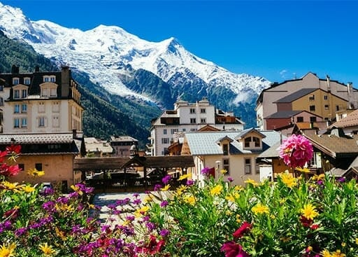 Chamonix france with snow cap mountains and flowers