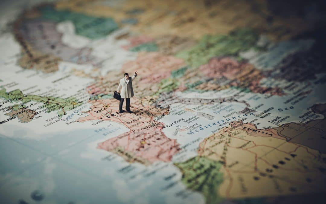 guy on map looking for places to travel in Europe